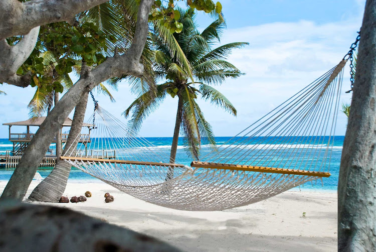 The Brac Reef Resort features hammocks on the beach of Cayman Brac.