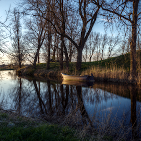 Still water by Mike Bing - Landscapes Waterscapes ( water, fortress, sunset, holland, boat, spaarnwoude, longexposure,  )