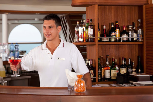 Seabourn_Sky_Bar_bartender-3 - At the Sky Bar on Seabourn Quest, you'll find open air drinking, entertainment and attentive bartenders.