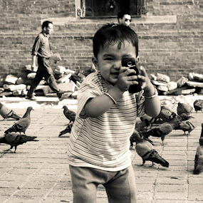 Everyone's a photographer these days. by Abhishek Shirali - Babies & Children Children Candids ( kathmandu, sepia, durbar square, children, candid, nikon, 18-55, nepal, mobile photography,  )
