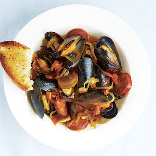 Steamed Mussels with Chorizo, Smoked Paprika, and Garlicky Croutons