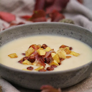 Celery Veloute  with Apples, Toasted Hazelnuts, and Bacon.