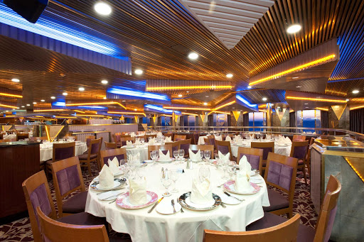 Carnival-Imagination-Pride-dining-room - The Pride dining room, one of Carnival Imagination's two main dining halls, serves fine food and wines.