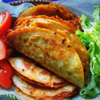 Tacos de Canasta Filled with Spicy Potatoes and Cheese.