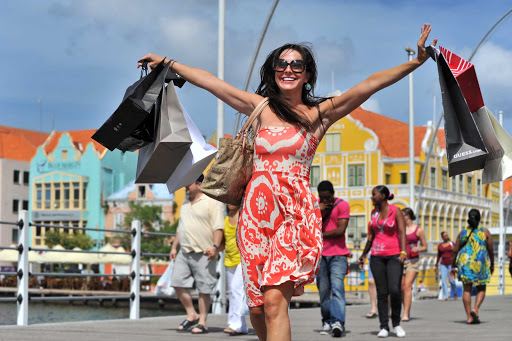 Curacao-Punda-shopping - A happy cruiser returns from the Punda shopping district in Willemstad, Curacao.