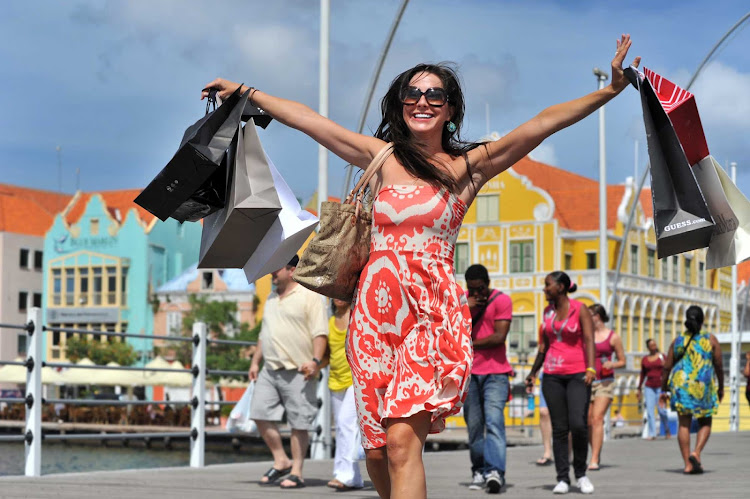 A happy cruiser returns from the Punda shopping district in Willemstad, Curacao.