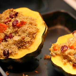 Baked Acorn Squash with Quinoa, Cranberry, and Apricot Stuffing.