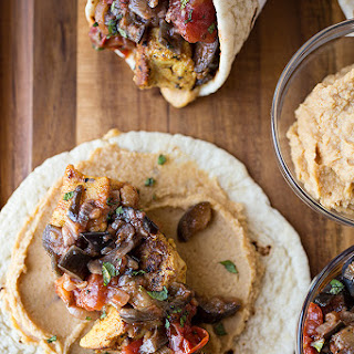 Spiced Moroccan Chicken Wrap with Grilled Eggplant, Tomato and Onion Chutney, with Spicy Hummus Spread and Fresh Mint.
