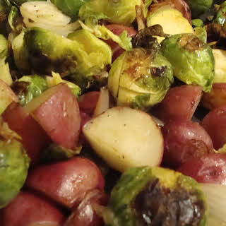 Pan-Roasted Brussel Sprouts with New Potatoes, Onions, and Crispy Parmesan.