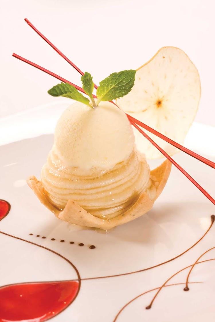 Enjoy Prime 7 Restaurant's classic desserts with a modern twist, such as apple pie à la Mode, during your journey aboard Seven Seas Voyager.