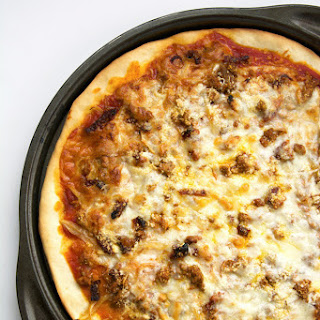Caramelized Onion, Sun Dried Tomato and Chorizo Pizza