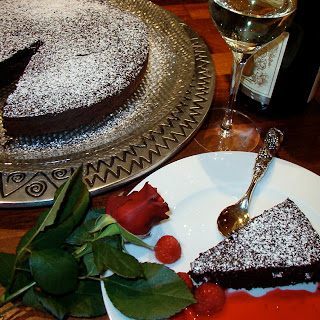 Decadent Flourless Chocolate Cake with Raspberry Coulis.