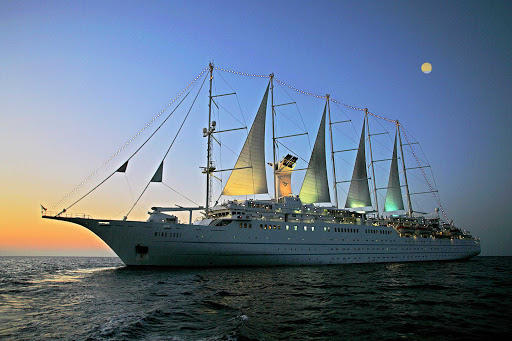 "Windstar-Cruises-Wind-Surf-sunset - Wind Surf at sea. Windstar calls it ""the world's largest sailing yacht,"" with 310 guests in 154 staterooms, every one with an ocean view."
