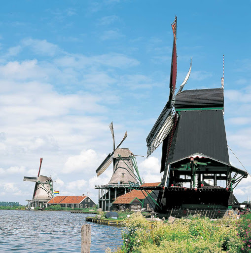 Zaandam-Zaanse-Schans-Holland - Windmills line the landscape at Zaanse Schans, a popular attraction for visitors near Amsterdam.