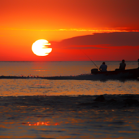 Three Men in a Boat by Mandy Jervis - Landscapes Waterscapes ( sunset dinas dinlle wales boat fishing evening beach waves sea ocean uk )