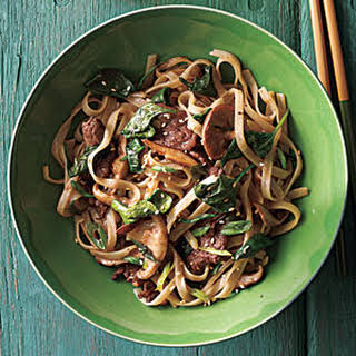Stir-Fried Rice Noodles with Beef and Spinach.