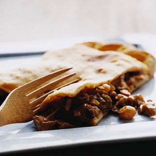 Chicken Empanada with Chorizo, Raisins, and Olives