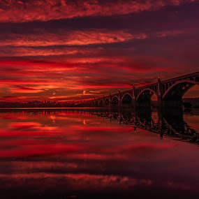 Red Sky at Night by Troy Snider - Landscapes Sunsets & Sunrises ( water, orange, red, sky, red sky, brilliant, bridge, river )
