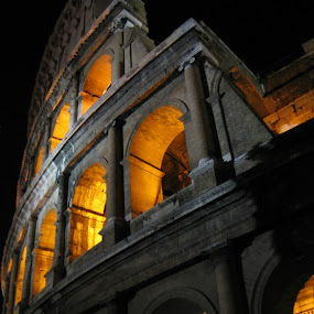 Roman Colosseum  by Jennifer Wheatley-Wolf - Buildings & Architecture Public & Historical ( orange, building, arena, ruins, night, jennifer wheatley, black, roman colosseum,  )