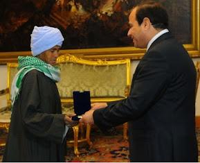 http://www.theguardian.com/world/2015/mar/22/egyptian-woman-award-lived-as-man