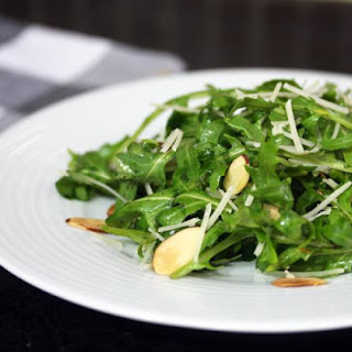 Baby Kale Salad With Toasted Almonds and Parmesan Cheese