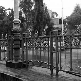 Streets after rain by Kaushik Mitra - Black & White Street & Candid