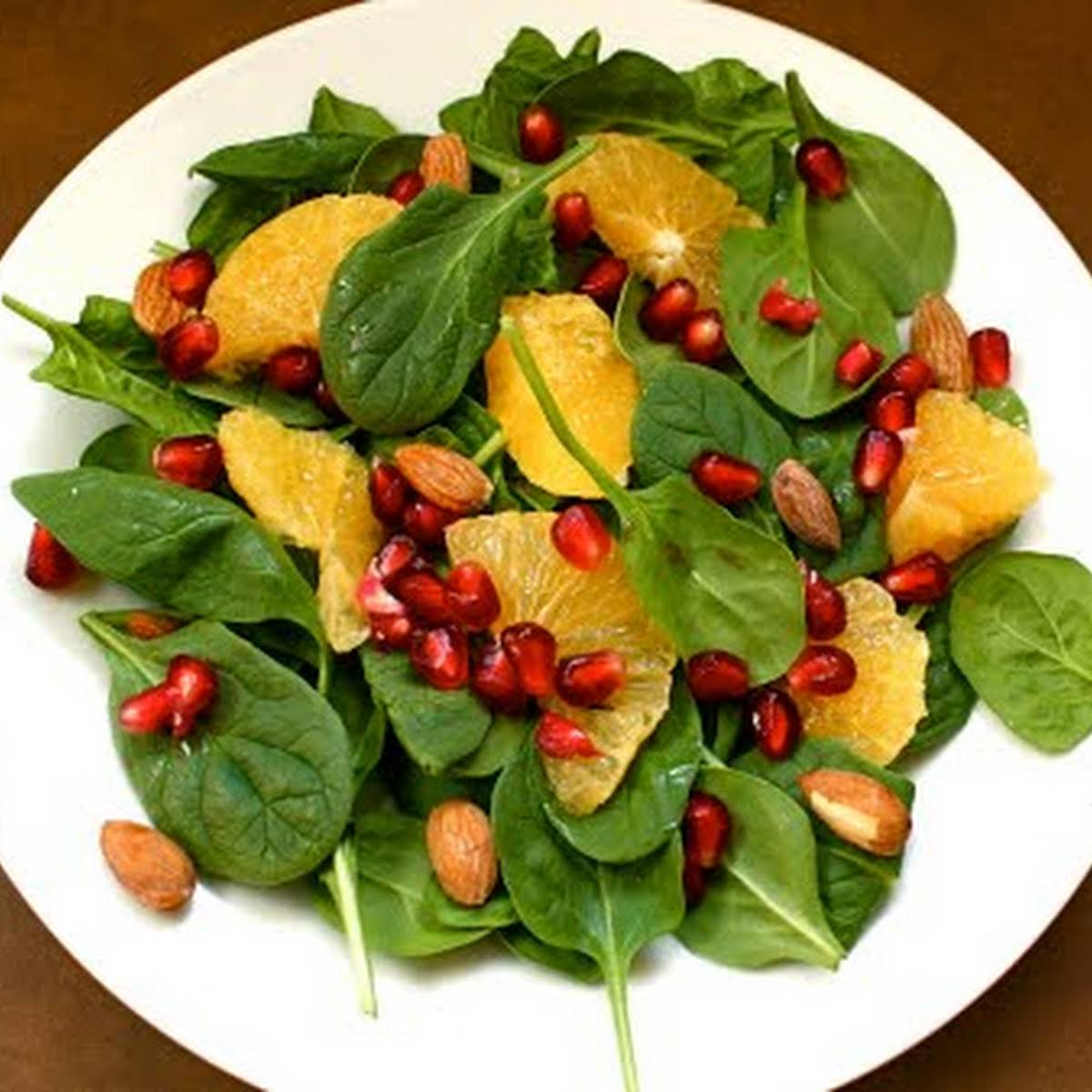 Spinach Salad  past Oranges, Pomegranate, and Almonds