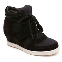 4eadd640791 Step out in style in these funky suede and canvas low wedge trainers by Ash.  They come in blue
