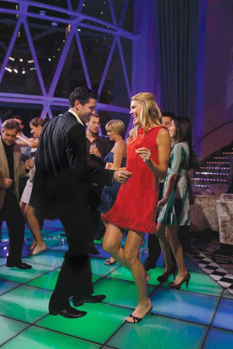 Dance the night away to a live band at Dazzles nightclub aboard  Oasis of the Seas.