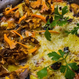 Tortilla or Spanish Omelet with wild mushrooms and crispy bacon.