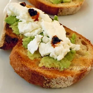 Avocado and Goat Cheese on Toasted Bread.