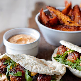 Spicy Pork Meatball Pittas With Harissa Mayo And Sweet Potatoes.