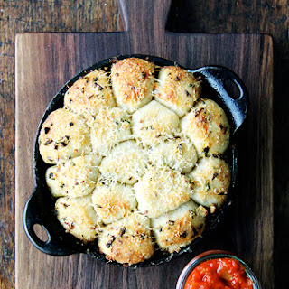 Garlic and Thyme Monkey Bread with Spicy Tomato Sauce.