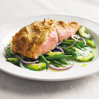 Hummus-Crusted Alaskan Wild King Salmon Over a Bed of French Beans, Red Onion, and Cucumber Salad with Lemon Oil.