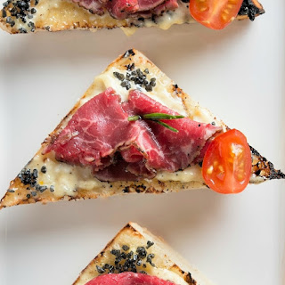 Beef and Garlic Carpaccio Crostinis