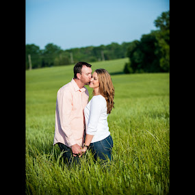 Kisses in the Grass by Mike Lesnick - People Couples