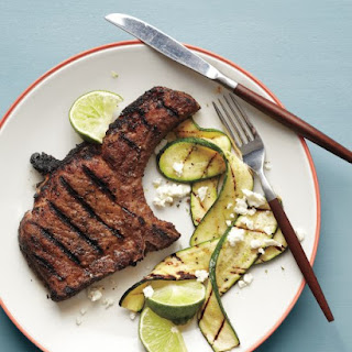 Spice-Rubbed Pork Chops with Grilled Zucchini.