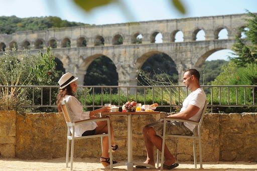 Have a breakfast beside the historic Pont du Gard, an ancient aquaduct system in Vers-Pont-du-Gard, France.