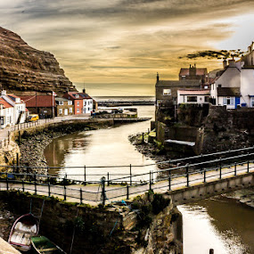 Staithes Village by Ryan Bedingfield - Landscapes Waterscapes ( water, hand rails, houses, cliffs, estuary, boats, sunrise, bridge, river )