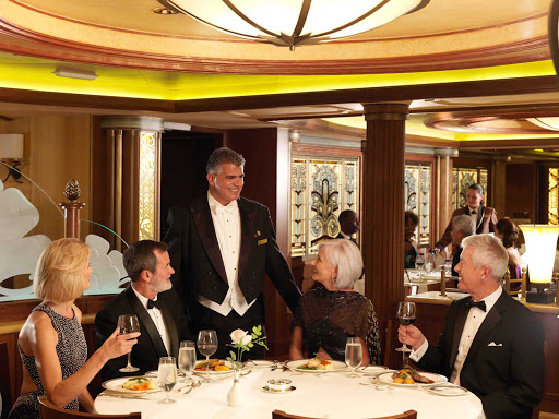 Cunard-Queen-Elizabeth-Princess-Grill - Diners and waiter at the Princess Grill aboard Queen Elizabeth.