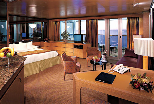 Holland-America-Flagship-Neptune-Suite - Neptune Suites, aka Deluxe Verandah Suites, aboard Holland America's ms Rotterdam and Amsterdam, run a comfy 571 to 653 square feet, including a private veranda, 2 lower beds convertible to a king, whirlpool bath and shower, sitting area, dressing room, mini-bar, fridge, floor-to-ceiling windows, daily breakfast service and more.