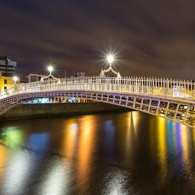 The Ha'penny Bridge - Dublin by Vaidotas Maneikis - Buildings & Architecture Bridges & Suspended Structures ( canon, ireland, dublin, hapenny, eire, night, flow, bridge, photography, river, colours, , mood factory, color, lighting, moods, colorful, light, bulbs, mood-lites )