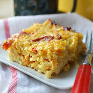 Cheesy Potato Breakfast Casserole with Cheddar & Sun-Dried Tomatoes.