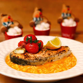 Pumpkin Risotto with Salmon and Cherry Tomato.
