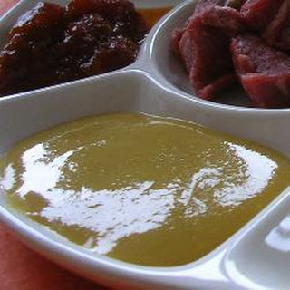 Beef Fondue With Curry And Mustard Sauces.