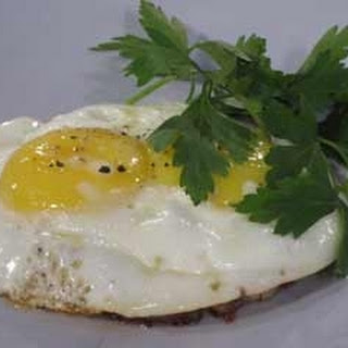Fried Eggs And Corned Beef Hash.