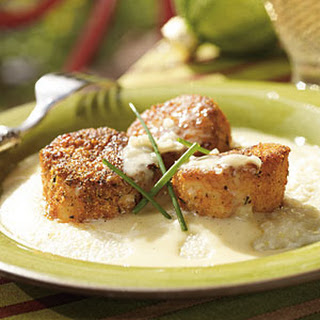 Blackened Sea Scallops over Stone-Ground Grits with Vanilla Beurre Blanc.