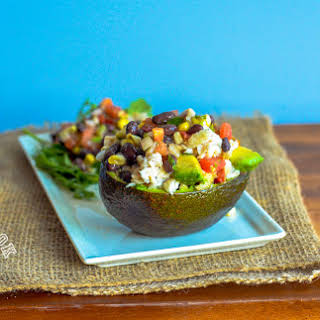 Tilapia Stuffed Avocado with Black Beans & Corn.