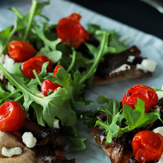 Balsamic Caramelized Onion Goat Cheese Pita Pizza with Arugula.