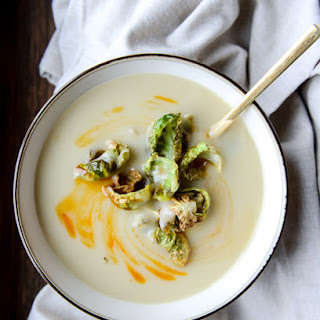 Creamy Roasted Garlic Potato Soup with Crispy Brussels.